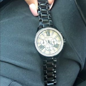 Men's black and gold MK watch